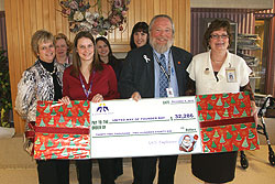 SJCG Employees Present Special Gift to the United Way