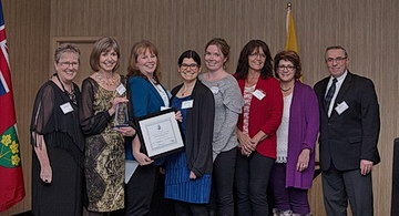 <strong>Exceptional Approach to Engagement Accolades for SJCG's Regional Palliative Care Program</strong> (from left to right): <strong>Laura Kokocinski</strong>, CEO, North West LHIN; <strong>Kathleen Lynch</strong>, Vice President, Rehabilitative Care &amp; Chronic Disease Management, SJCG; <strong>Jill Marcella</strong>, Coordinator, North West LHIN Regional Palliative Care Program, SJCG; <strong>Hilary Mettam</strong>, Community Development Lead, North West LHIN Regional Palliative Care Program, SJCG; <strong>Rebecca McEwan</strong>, Clinical Co-Lead, North West LHIN Regional Palliative Care Program, SJCG; <strong>Cindy Harvey</strong>, Administrative Assistant, North West LHIN Regional Palliative Care Program, SJCG; <strong>Marlene Benvenuto</strong>, Telemedicine Palliative Registered Nurse Consultant, Regional Palliative Care Program, SJCG; <strong>Gil Labine</strong>, Board Chair, North West LHIN; <strong>Dr. Kathy Simpson (Missing from Photo)</strong>, Clinical Co-Lead, North West LHIN Regional Palliative Care Program, SJCG;