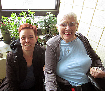 Michelle and Myra, on a balcony at Bethammi Nursing Home, where Myra tends to some of her dozens of plants.